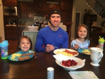 Here I am enjoying a typical meal of eggs and bacon, cooked with butter. The two pretty girls by my side belong to two of my hardest working clients. We work hard and eat well!